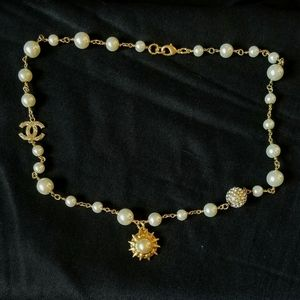 Authentic chanel Sun and cc charm necklace